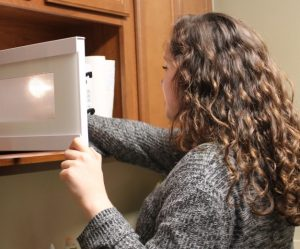student using microwave